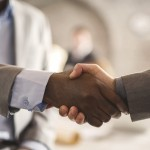 Unrecognizable business people shaking hands.